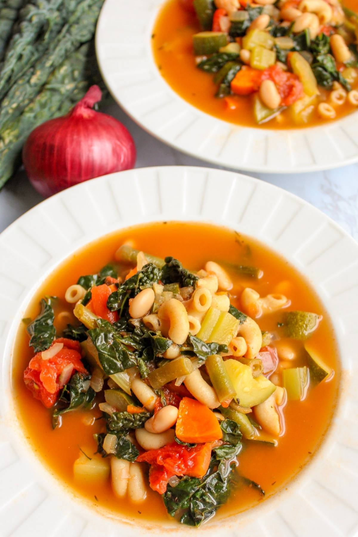 Vegan minestrone soup in a white bowl.