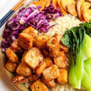 Tofu buddha bowl filled with tofu, rice and vegetables