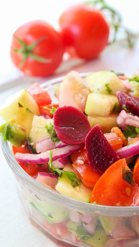 Tomato and cucumber salad in a glass bowl