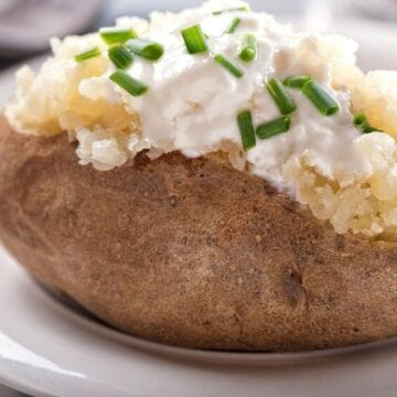 Baked potato topped with sour cream
