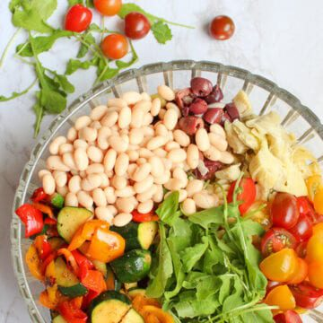 Grilled vegetable pasta salad in a glass bowl