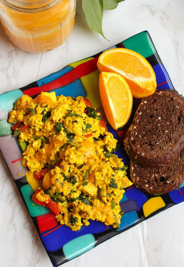 vegan tofu scramble with vegan sausage on a plate