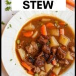 bowl of vegan beef stew with test overlay for pinterest