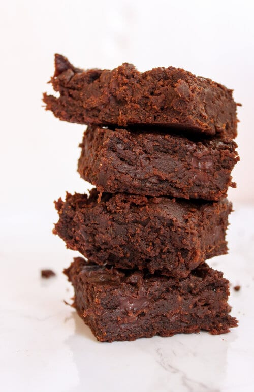 four sweet potato brownies stacked on each other