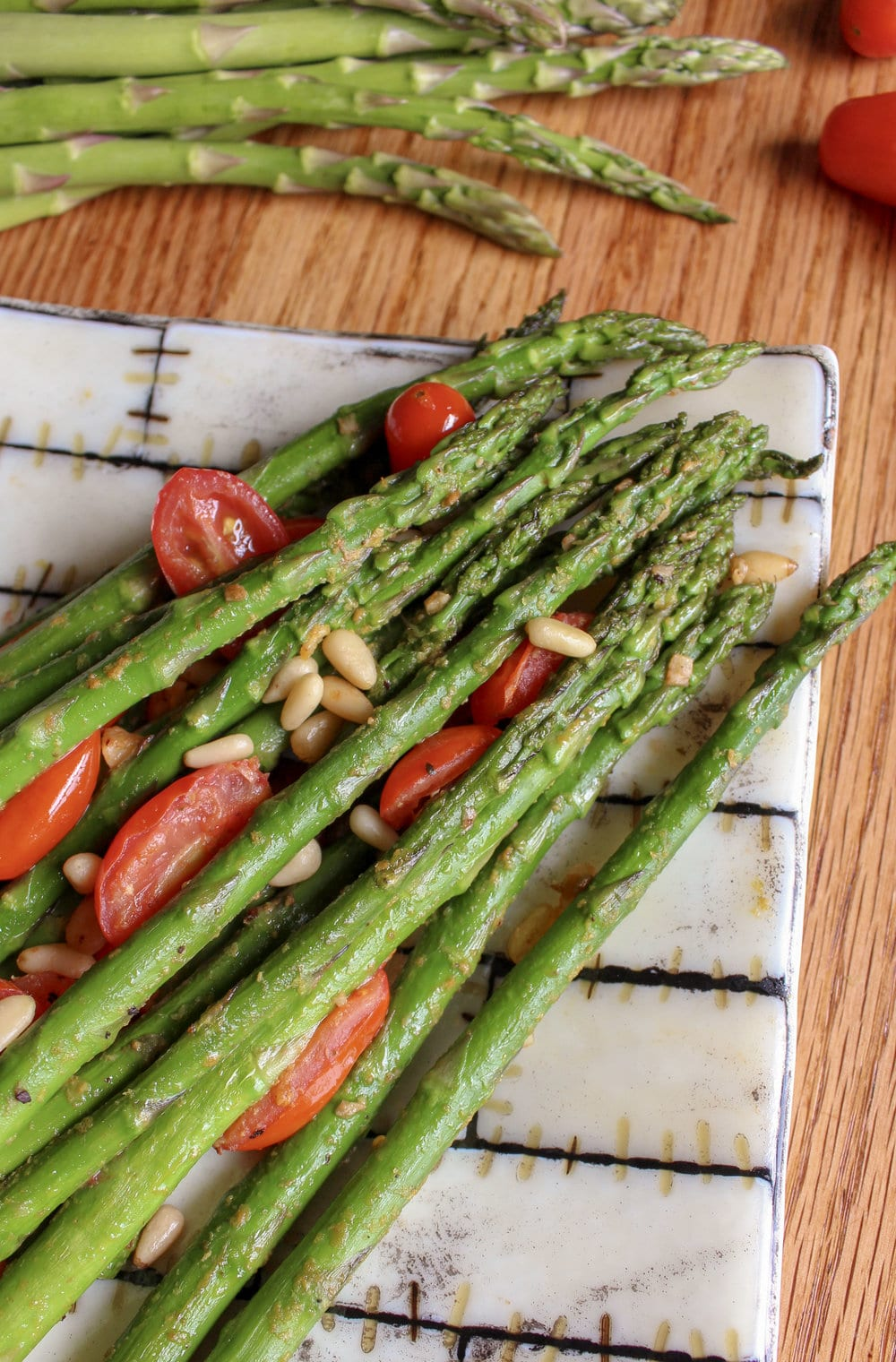 Asparagus and roasted tomatoes on a plate