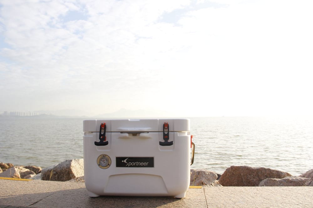 cooler on a sidewalk by the beach