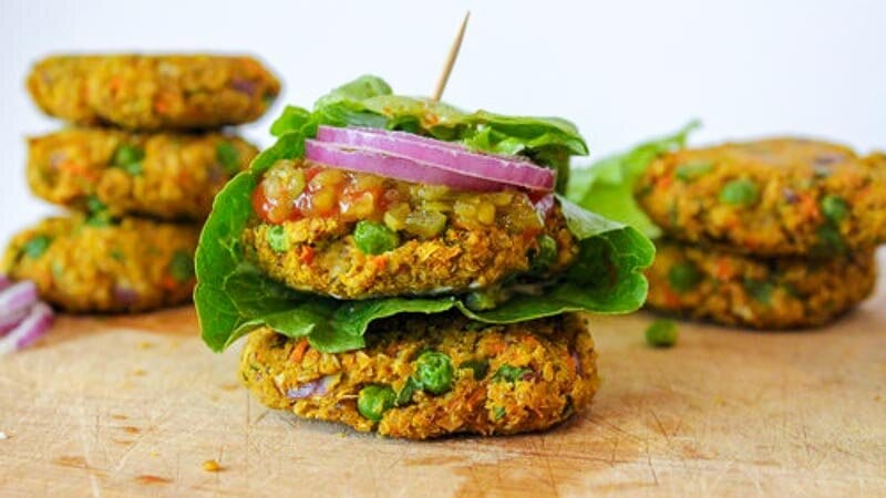 quinoa and vegetable burger patties stacked on each other