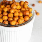 close up of crispy chickpeas in a small white bowl.