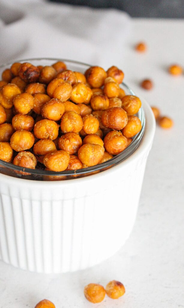 Crispy chickpeas in a small white bowl - close up.