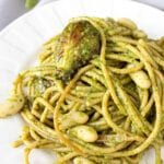 A plate of vegan pesto pasta with roasted vegetables