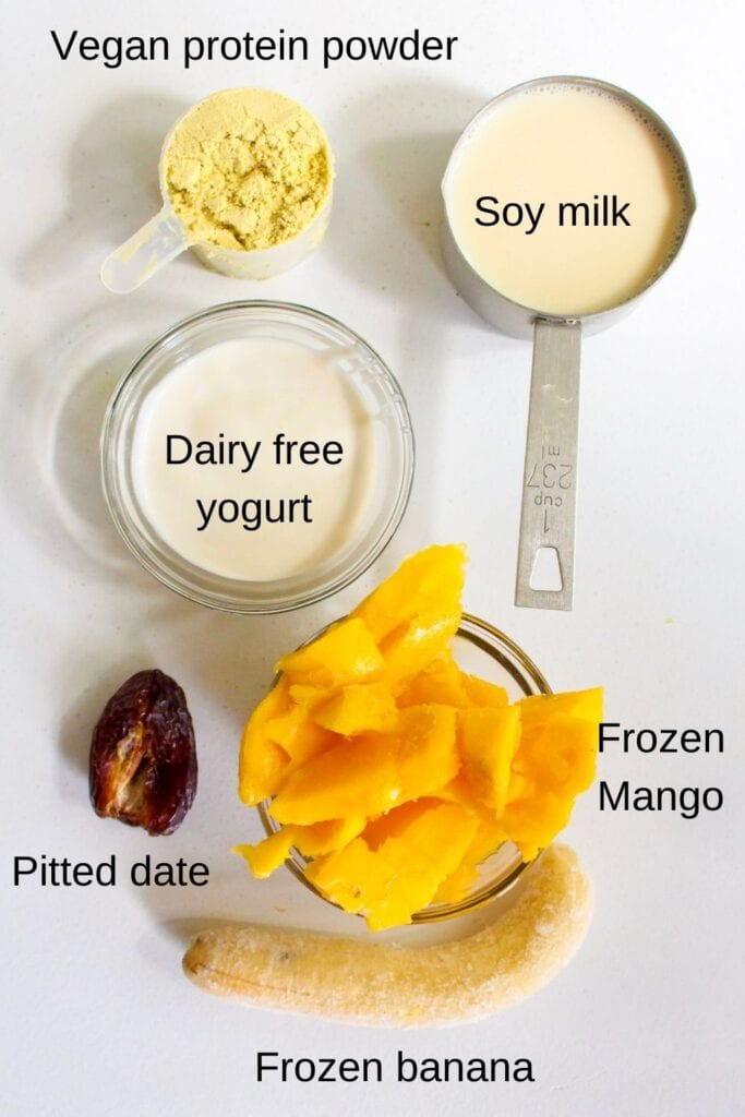 Ingredients for mango protein smoothie laid out