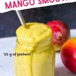 Glass mason jar filled to the brim with mango protein smoothie