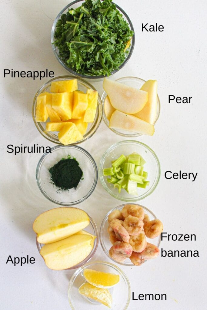 Ingredients for spirulina smoothie laid out individually in glass bowls