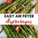 Roasted air fryer asparagus on a plate with cherry tomatoes