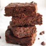 Four vegan black bean brownies stacked on top of each other