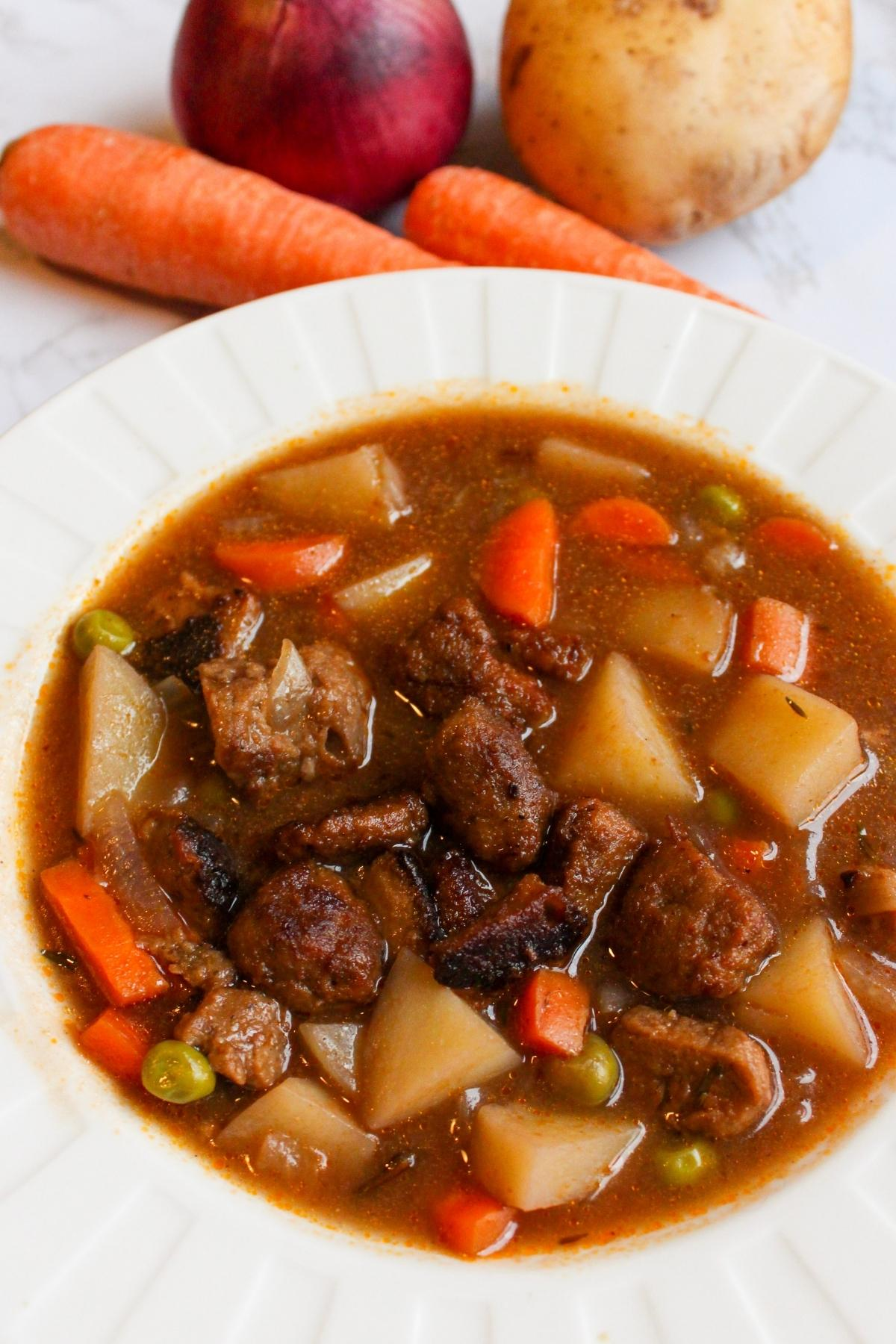 Close up of vegan beef stew in a bowl.